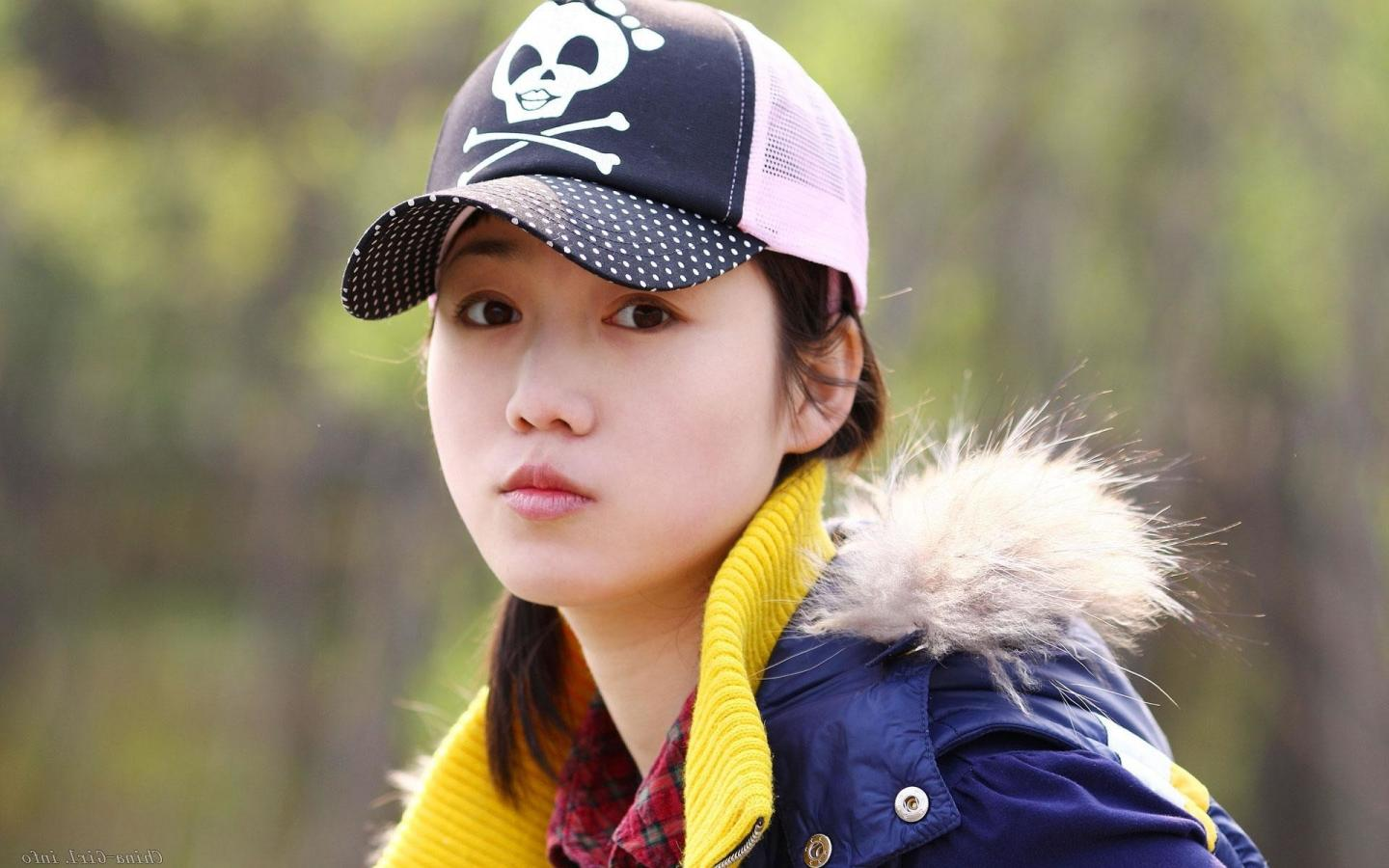 Beautiful girl wear nice cap and jacket wallpaper